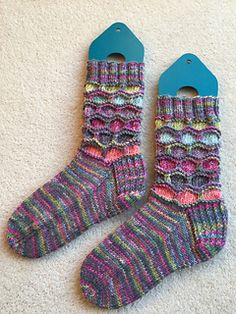 These slipper socks were designed for the Stylecraft Blogtour 2017 using the Country Garden yarn pack of Batik and Batik Elements yarn. The slipper socks uses a slip stitch pattern to form hexagons of colour, separated by garter stitch ridges. The pattern is available in two sizes, small/medium and medium/large adult and the pattern uses less than 100g of yarn for one pair of slipper socks.