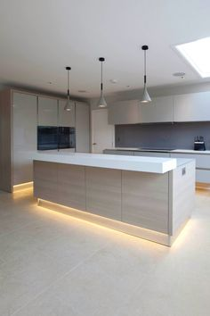 Love the lighting detail and breakfast bar shelve
