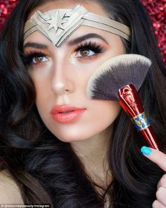 Go for the gold: Vlogger Victoria Lyn Beauty complemented the metallic accents on her Wonder Woman costume with lustrous highlighter and a glossy lip Couple Halloween Costumes For Adults, Costumes For Teens, Halloween Make Up, Halloween Face Makeup, Couple Costumes, Pirate Costumes, Princess Costumes, Group Costumes, Adult Costumes
