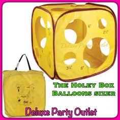 The Holey Box balloon sizer. Medidor de globos