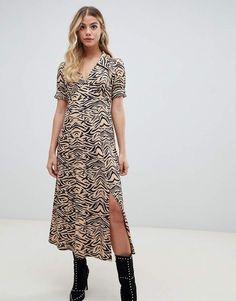 ASOS DESIGN animal print midi tea dress in rib at asos.com 17423ee88
