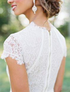 Lace high neck short sleeve wedding gown: http://www.stylemepretty.com/2016/02/23/trend-short-sleeve-wedding-dresses/