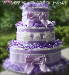diaper cake purple, cute bows. Diaper cake for a baby girl.