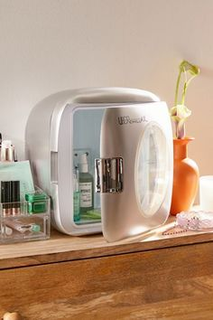 Mini Refrigerator | Urban Outfitters Tiny Fridge, Mirrors Urban Outfitters, Home Hair Salons, Mini Washing Machine, Hair Removal Systems, Compact Refrigerator, Makeup Brush Cleaner, Beauty Sponge, Polyurethane Foam