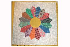 How to Make Easy Dresden Plate Quilt Blocks...by Janet Wickell...An easy Dresden Plate quilt block pattern that takes the chore out of turning under all of those edges of the blades. Give this Dresden Plate block a try.