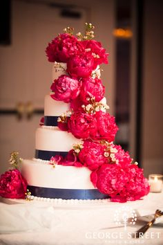 blue and white cake with hot pink flprals