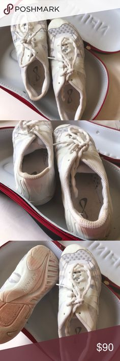 NFINITY CHEER SHOES only wore these shoes two or three times before i decided to quit cheerleading. the red stain on the bottom is from the track at the high school. would probably come out of you washed them. size 8: style vengeance nfinity Shoes