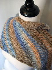 Our crochet Clapochet is also worked on the diagonal, with chain spaces peppered throughout to create a texture similar to the original Clapotis. If variegated yarn is used, it will stripe with the texture instead of against it, but the final result is just as versatile as the original in that it may be scrunched up and worn as a scarf or spread out and worn as a shawl.