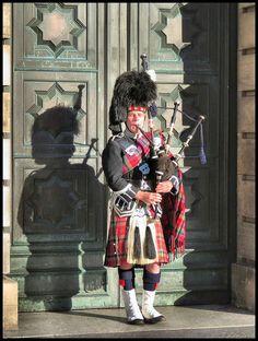 The ubiquitous Scottish Bagpiper on The Royal Mile Edinburgh