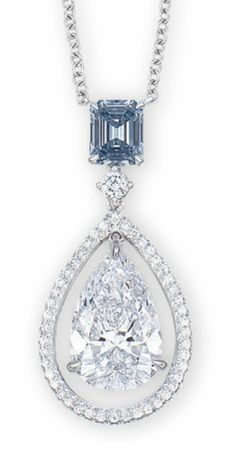A COLOURED DIAMOND AND DIAMOND PENDENT NECKLACE  THE RECTANGULAR-SHAPED FANCY INTENSE BLUE DIAMOND WEIGHING 0.56 CARAT, SUSPENDING A PEAR-SHAPED DIAMOND WEIGHING 3.06 CARATS, WITHIN A BRILLIANT-CUT DIAMOND FRAME, SPACED BY A BRILLIANT-CUT DIAMOND, JOINED TO A COLLET-SET BRILLIANT-CUT DIAMOND FINE NECKCHAIN, MOUNTED IN 18K WHITE GOLD, 40.8 CM LONG