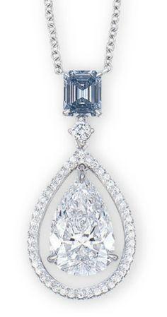 BLUE DIAMOND WEIGHING 0.56 CARAT SUSPENDING A PEAR-SHAPED DIAMOND WEIGHING 3.06 CARATS, WITHIN A BRILLIANT-CUT DIAMOND FRAME, SPACED BY A BRILLIANT-CUT DIAMOND, JOINED TO A COLLET-SET BRILLIANT-CUT DIAMOND FINE NECKCHAIN.