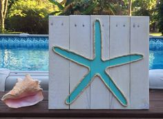 A personal favorite from my Etsy shop https://www.etsy.com/listing/221965907/handmade-starfish-with-rope-beach-pallet