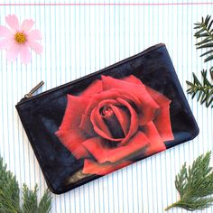 Flower collection by Malvi, made with vegan and Eco-friendly materials. This red rose flower medium pouch has matching cross body bag, wristlet wallet and small pouch. Wholesale available at www.mlavi.com. Shop now at https://mlavi.ca/search?page=1&q=flower&type=product #flower #vegan #fashion #accessories #gift #wholesale #wallet #bag #purse #pouch #shopping