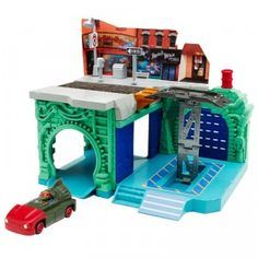 The playset features an underground sewer lair area with a garage lift.