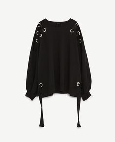 SWEATSHIRT WITH EYELETS