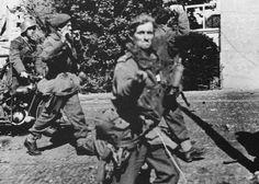 Captured British Airborne at Arnhem, Lt Jack Reynolds gives the 'two fingers' to the German camera man.