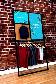 Metal Leaning Garment Rack w/ 2 Custom Printed Posters, 1 Hanging Rod – Black This custom leaning wall merchandise display rack is an all-in-one showcase. Clothing Store Displays, Store Window Displays, Retail Displays, Shop Displays, Retail Fixtures, Store Fixtures, Visual Merchandising Displays, Retail Store Design, Retail Stores