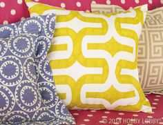 This dare-to-be-bold trio gives duck cloth décor a darling dose of eclectic charm. Grab ready-made pillow inserts, pick a pile of pretty patterns, and start stitching—we used Simplicity pattern #9873 for all three.