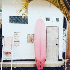 pink surfboard + white walls.