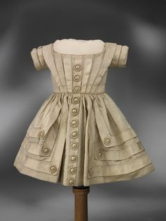 A very smart boy's silk dress made in England, circa 1850. I love the fake button detailing. by silvia