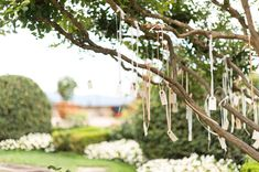 Escort Cards Hanging in the Tree | Destination DIY vintage wedding in Italy | Martina Liana Dress | Styling by WedInItaly | Pink and gold colour scheme | outdoor reception | Images by Anushé Low | http://www.rockmywedding.co.uk/lavinia-sav/