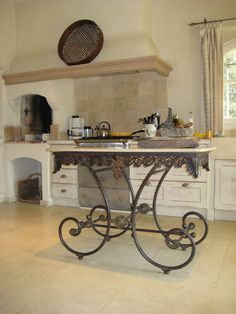Designer, Alix Rico ~ House in Roussillon, Provence.  Photo via Veranda Magazine.    Maison & Co. has a few beautiful French Butcher tables similar to this one for sale on our website:  http://www.maisonandco.com/antiques-category/Furniture