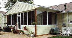 A traditional sunroom with gable roof and wood trim. #homeimprovement #sunrooms