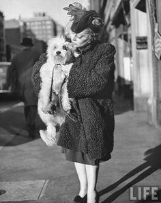 Pooch being cuddled by its owner former Metropolitan Opera singer Thalia Sabaneeva; by LIFE photographer Nina Leen, 1944.