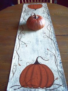 My hand painted table runner...I love to paint pumpkins.
