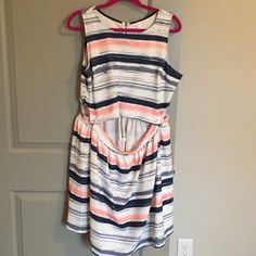 NWOT Striped Dress NWOT Striped Dress. Suppose to look like a top and skirt from the front! Adorable style! Is stretchy! Xhilaration Dresses