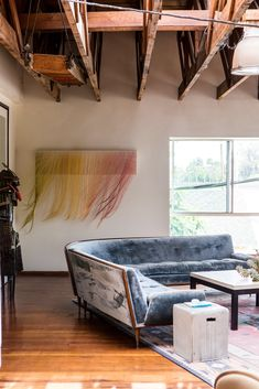 """A string piece by the artist Nike Schroeder, a friend of the designers who is represented by the Walter Maciel Gallery. """"It has a gentle, seductive dynamism that really complements the energy of our studio and home,"""" Andrew Paulson says. (Photo: Laure Joliet)"""
