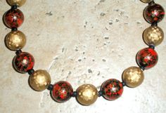 A single strand of vintage beads by d3tennis on Etsy, $40.00