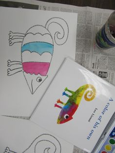 1st graders listened to a story about a cute little Chameleon by Leo Lionni. This lesson was originally from Deep Space Sparkle. First we drew our own chameleons with black crayon. It's easy once y...