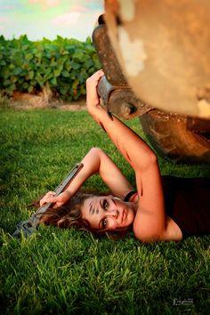 Girl under a truck
