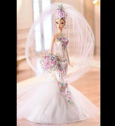 2006: Couture Confection Bride Barbie A fantasy wedding gown designed by Bob Mackie (best known for outfitting divas like Diana Ross and Cher), this sparkly floral gown is topped with a dramatic veil. Photo via Barbie Collector  Our Favorite Wedding Barbies|Bridal Guide