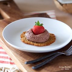 Coconut Tuiles, a thin and delicate coconut cookie with a chewy texture, served with a dairy-free Chocolate Whipping Cream and fresh strawberries.