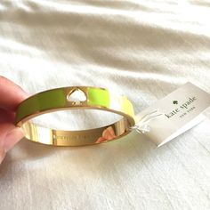 listing! Kate Spade Hole Punch bangle Brightly colored enamel bangle bracelet. Hinged for easy on-easy off wear. Gold with Tobacco Leaf enamel (it's like a bright chartreuse). kate spade Jewelry Bracelets