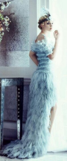 Fanciness is the beauty of fluffy feather and soft color is bringing the nature of comfort and beauty. (Chanel dress).