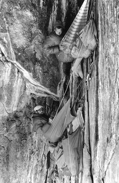 Tom Frost, Royal Robbins and Yvon Chouinard in bivy sacks in the Black Cave during the first ascent of the North America Wall, El Capitan, 1964. Photo taken by Chuck Pratt.