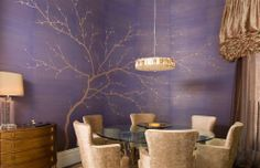 Very glam...love the periwinkle color. What looks like beads on the branches is actually embroidery on the wallpaper.
