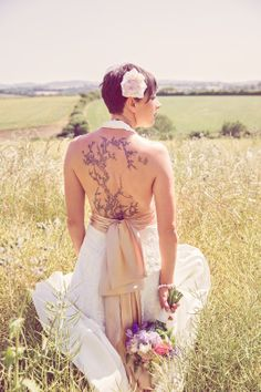 Tattoo and wedding dress Photos by mckenzie brown photography