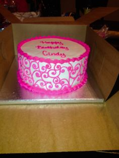 Hot pink cake with scroll work icing on sides