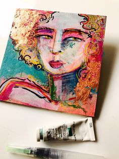 Original mixed media painting on MDF. A self assured lady with golden eyes and hair. Gilded with gold leaf and full Of colour and many many marks