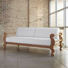Inspired by an antique daybed, the exaggerated scrolls and proportions of the Brush sofa are pure Paola Navone…