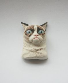 Hey, I found this really awesome Etsy listing at http://www.etsy.com/listing/156054061/unofficial-grumpy-cat-magnet-glazed