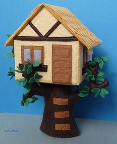 Felt house in the tree.. €50,00, via Etsy.
