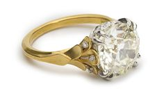 Flora Ring centers one old European cut diamond weighing 4.04 carats.