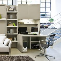 "The Home Office is a wonderful compliment to any of the Space Saving Bed systems. Housed in a cabinet that is just 13 3/4 inches deep, the Home office includes: shelving below to accommodate a printer, a fitting for a PC tower, a sizeable desk surface (42 1/2"" x 40 3/4""), a built-in lighting fixture and additional storage above the desk."