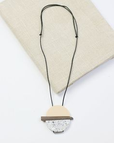 Cream Resin and Wood Pendant Necklace by Sylca