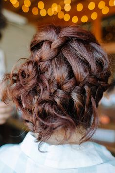 Try this pretty braided updo for your homecoming hairstyle this year.